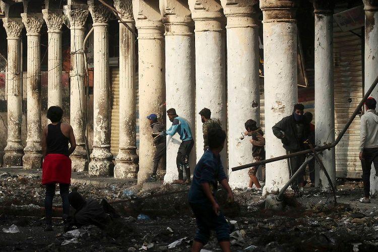Bağdadda naməlum silahlılar azı 16 aksiya iştirakçısını öldürüb