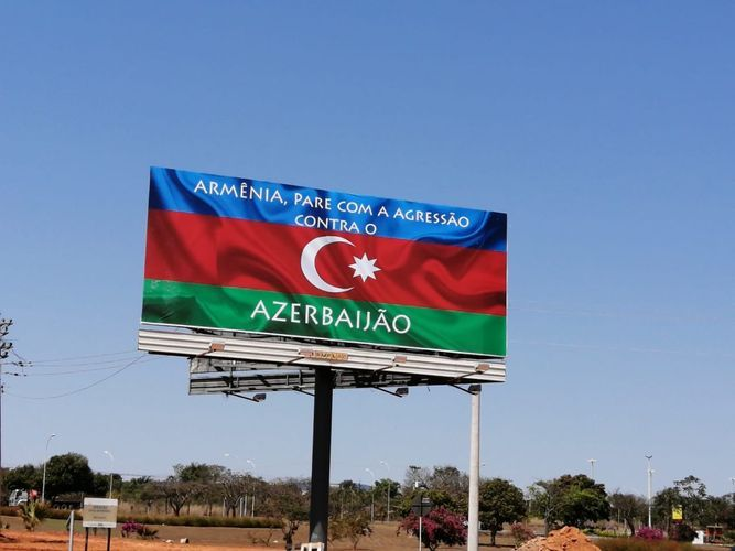 """Panel covered with writing that says """"Armenia, stop aggression against Azerbaijan!"""" set on highway in Brazil"""