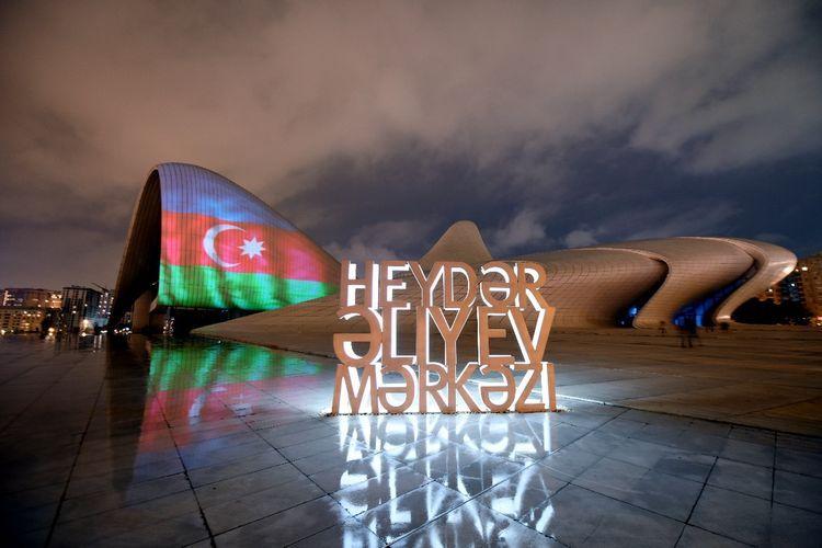 Heydar Aliyev Center, Flame Towers and Baku Olympic Stadium illuminated with Azerbaijani flag  - PHOTO