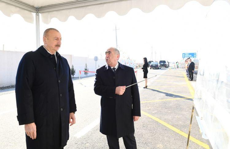 Prezident İlham Əliyev Kürdəmirdə avtomobil yolunun açılışında iştirak edib  - <span class=