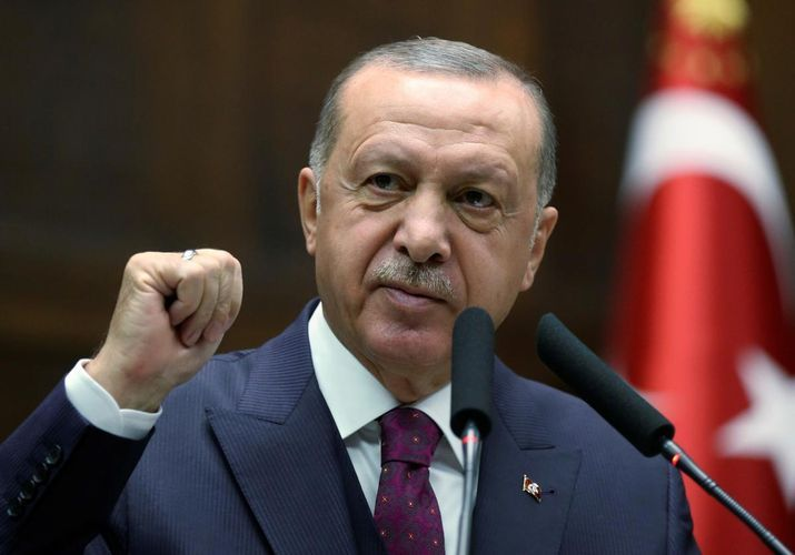 Erdogan vows to keep doors open for refugees heading to Europe