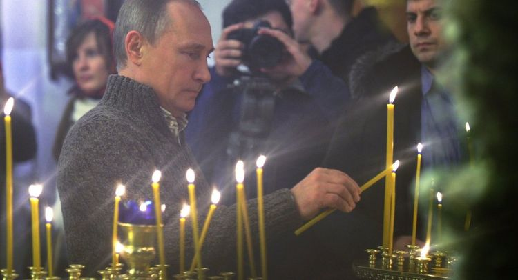 Russian President Putin attends Christmas service at Transfiguration Cathedral in St. Petersburg