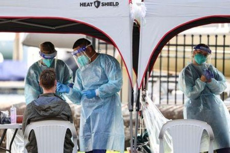 Australia reports record spike in coronavirus cases, 13 deaths
