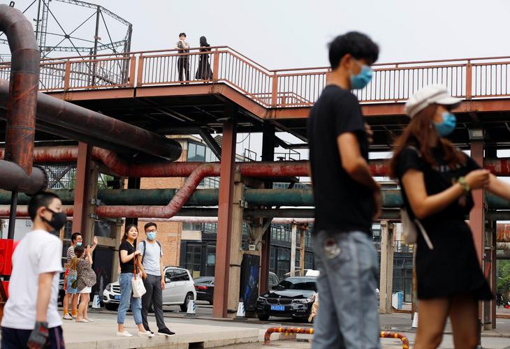 Mainland China reports 13 new coronavirus cases, including 11 in Beijing