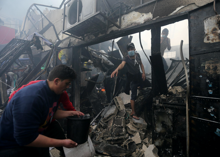 Ten killed in Gaza after bakery fire sweeps through packed market