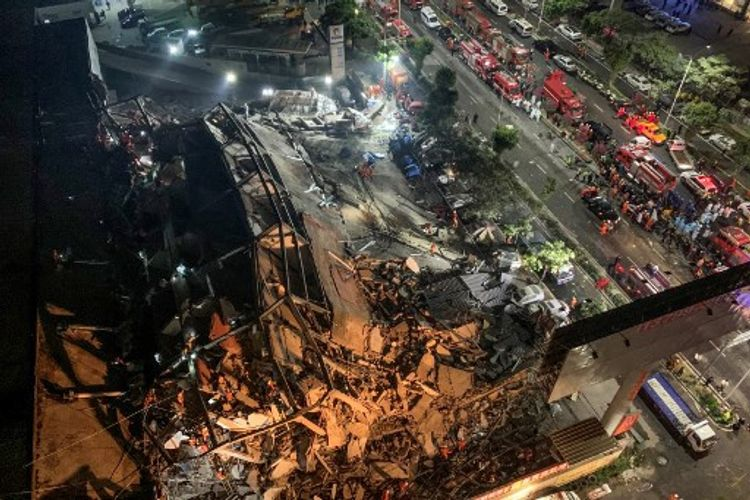 Death toll rises to 18 in east China hotel collapse