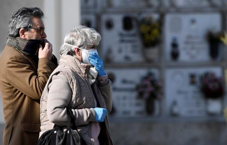 COVID-19 death toll in Italy rises by 889 to top 10,000