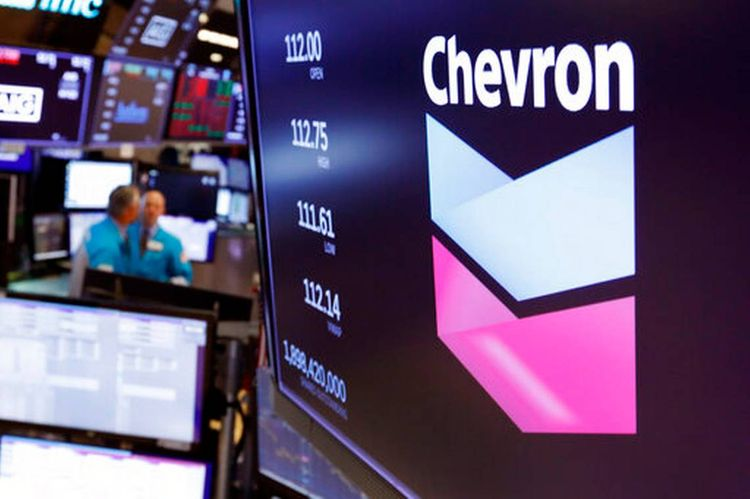 Chevron turns a profit but warns of pain ahead