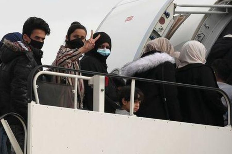 Migrants stranded in Greece by COVID-19 fly to UK