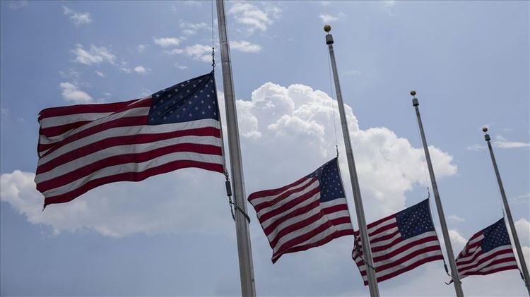 US to lower flags to half-staff to mourn virus victims