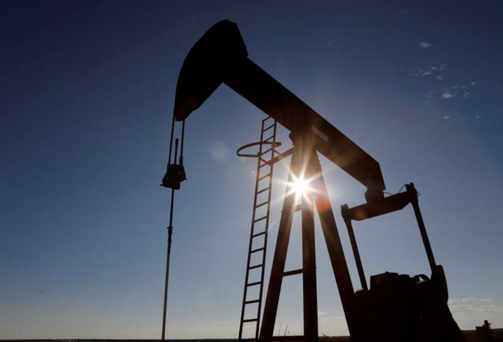 Oil falls as COVID-19 spike stokes fuel demand fears; still set for big weekly gain