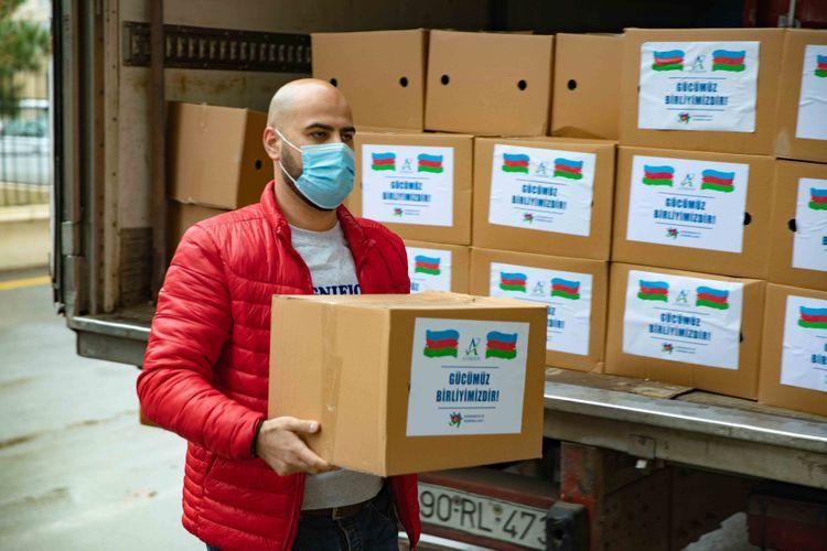Azersun Holding оказал продовольственную помощь семьям пострадавших в результате вражеского обстрела в регионах - ФОТО