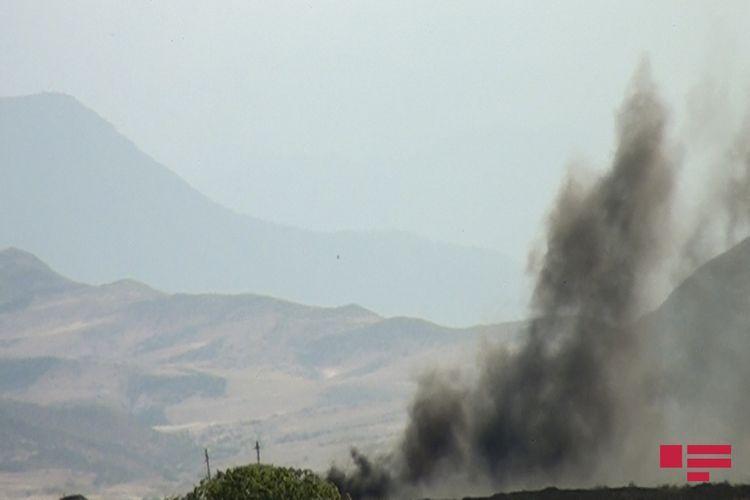 Armenian troops, leaving Aghdam, set fires