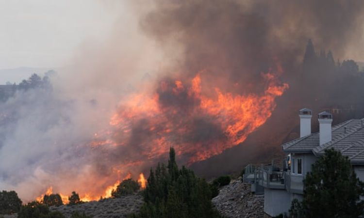Fresh wildfires in Nevada and California force evacuations and kill at least one