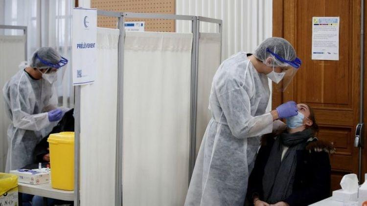 France orders curfew in nine cities to battle virus