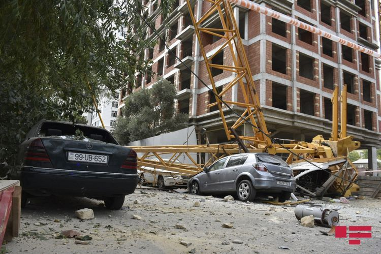 Two houses damaged as a result of crane turnover onto residential building in Baku - <span class=