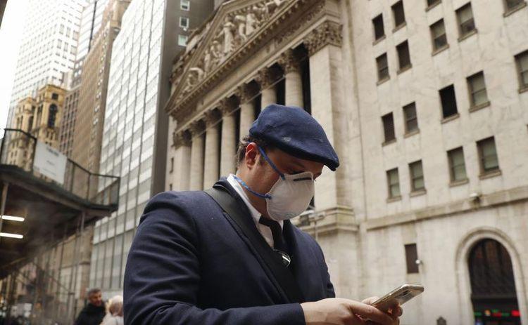COVID-19 vaccine hopes lift world stocks, dollar eases