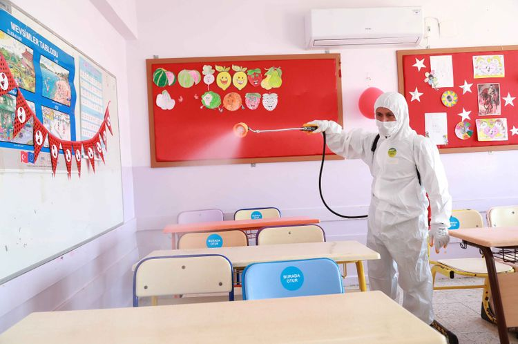 Some students back in classrooms as schools in Turkey partially reopen