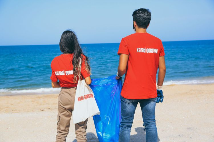 """Environmental campaign held at the beaches of Baku under the motto of """"Protect the Caspian Sea!"""" - <span class="""