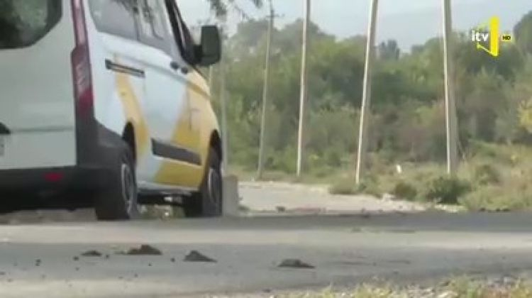 Projectile, shelled by Armenians, falls on near car of Ictimai Television