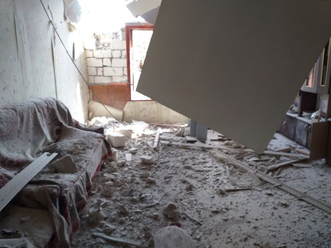 Projectile, shelled by Armenians using heavy artillery hits house