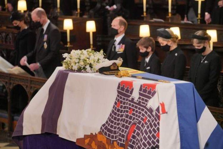 Queen Elizabeth stands alone as her