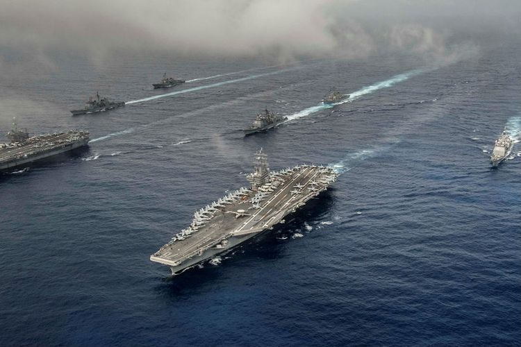 China urges U.S. to strictly restrain its warships, aircraft