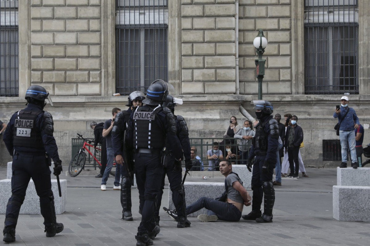 French police clash with anti-vaccine passport protesters in Paris