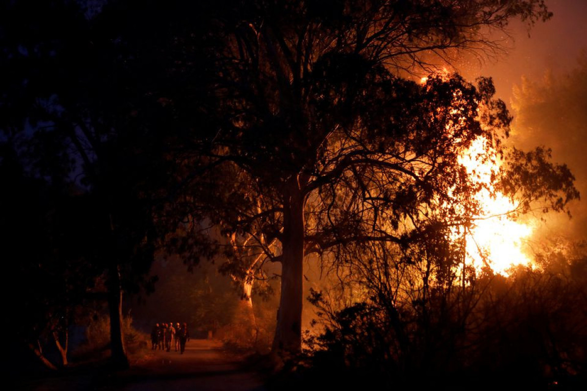 Greece battles wildfires for third day, site of ancient Olympics saved