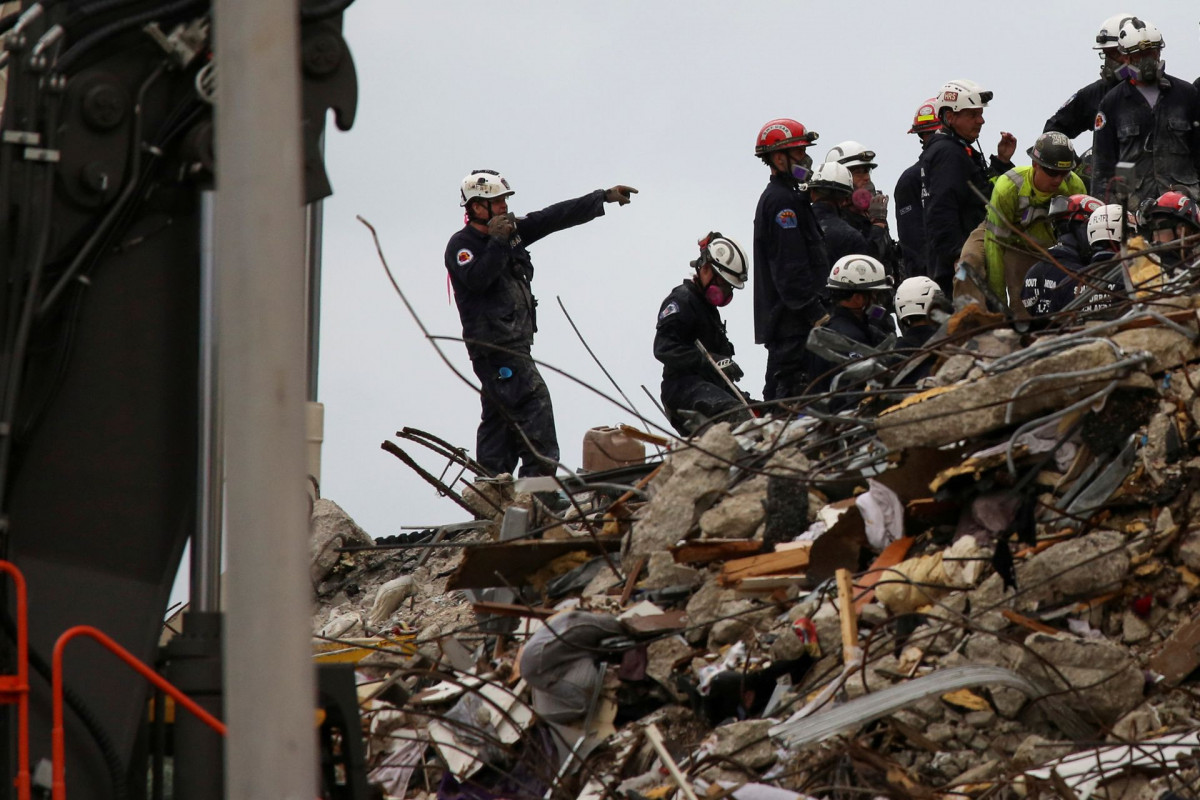 Death toll in Florida condo collapse at 20, firefighter