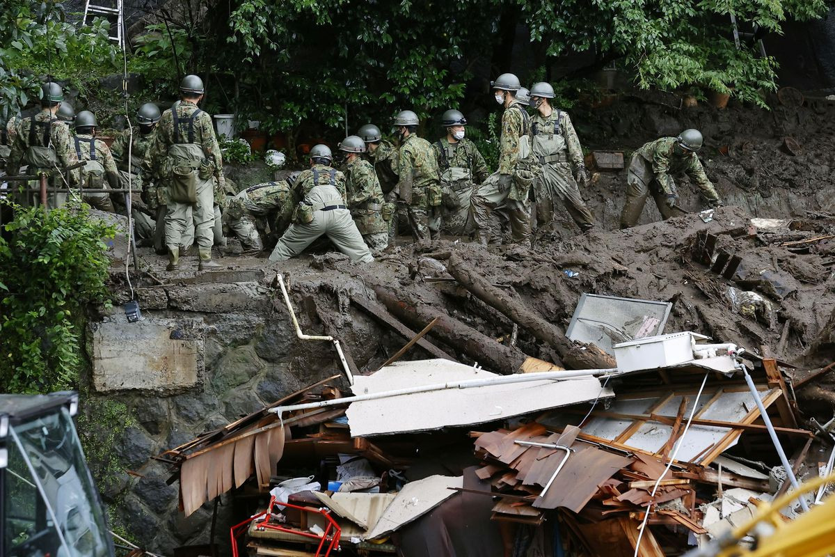 Rescuers fight time, weather in Japan landslide; over 100 missing