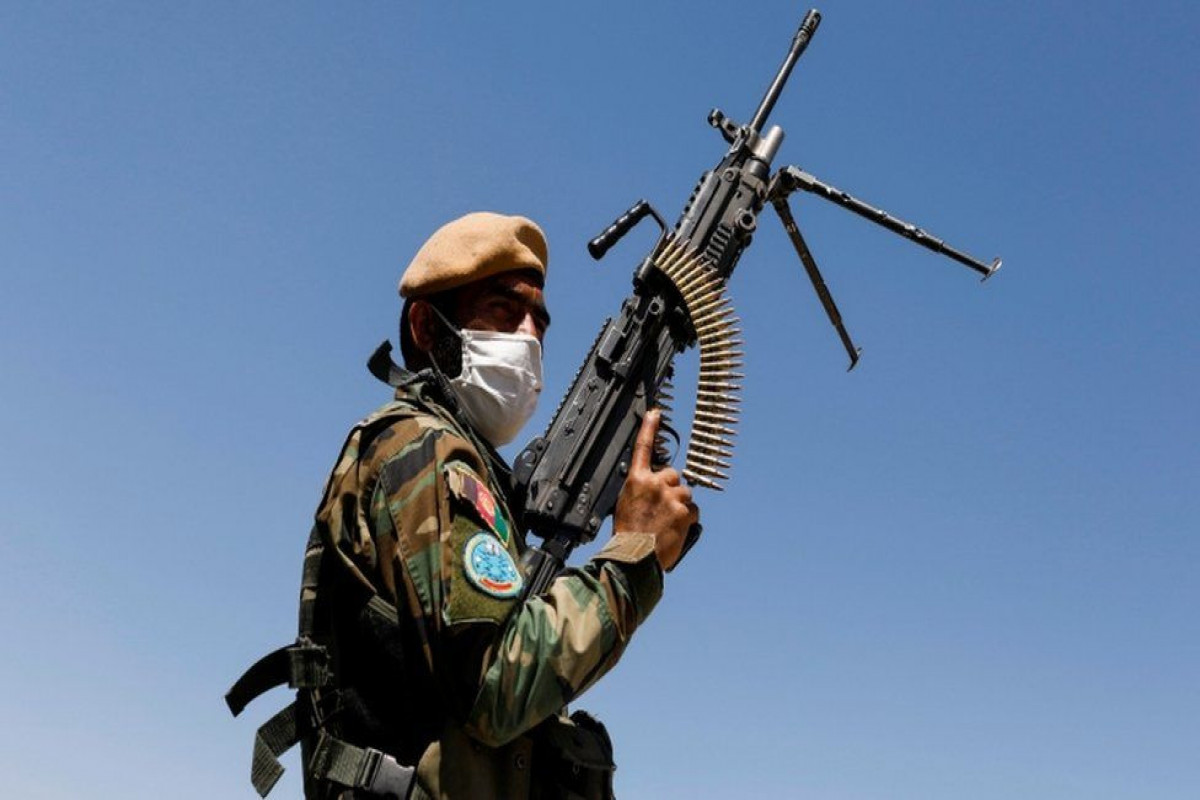 Afghan troops flee country after Taliban clashes