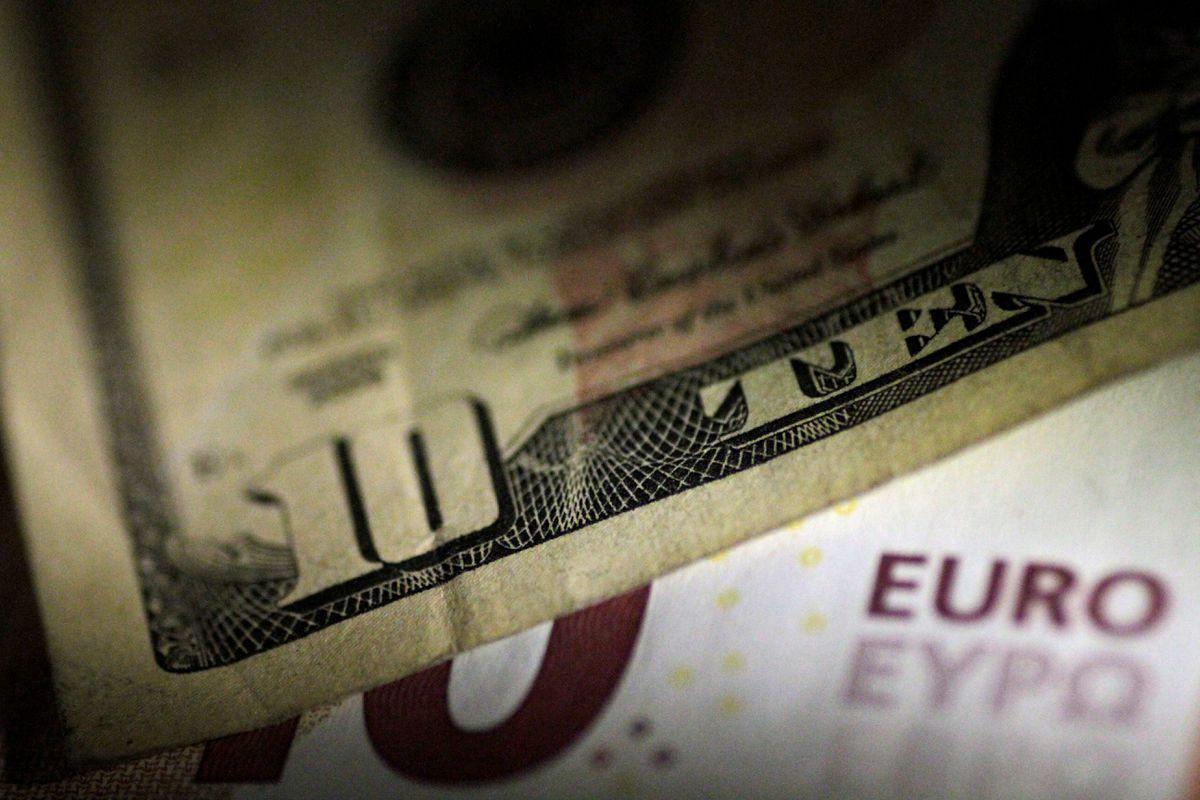 Dollar edges higher as market awaits clues from U.S. Fed