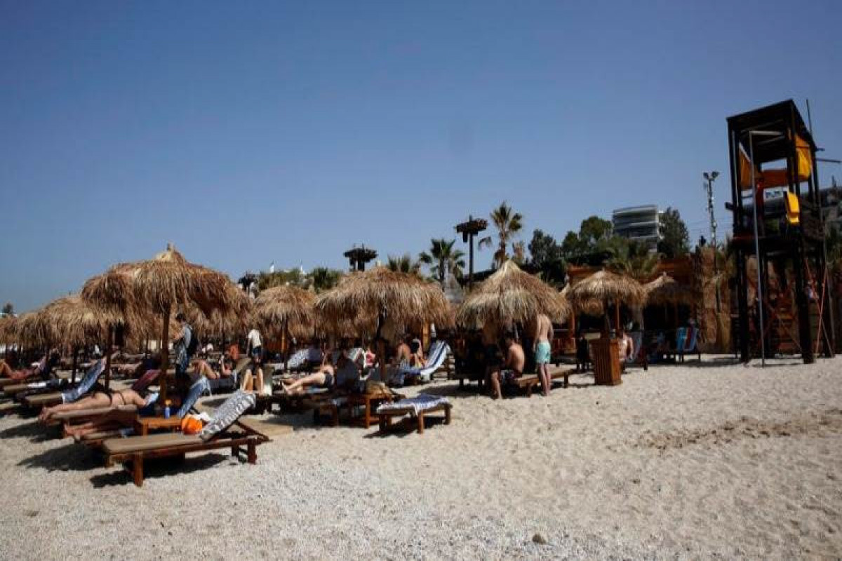 Greece allows seated customers only in bars