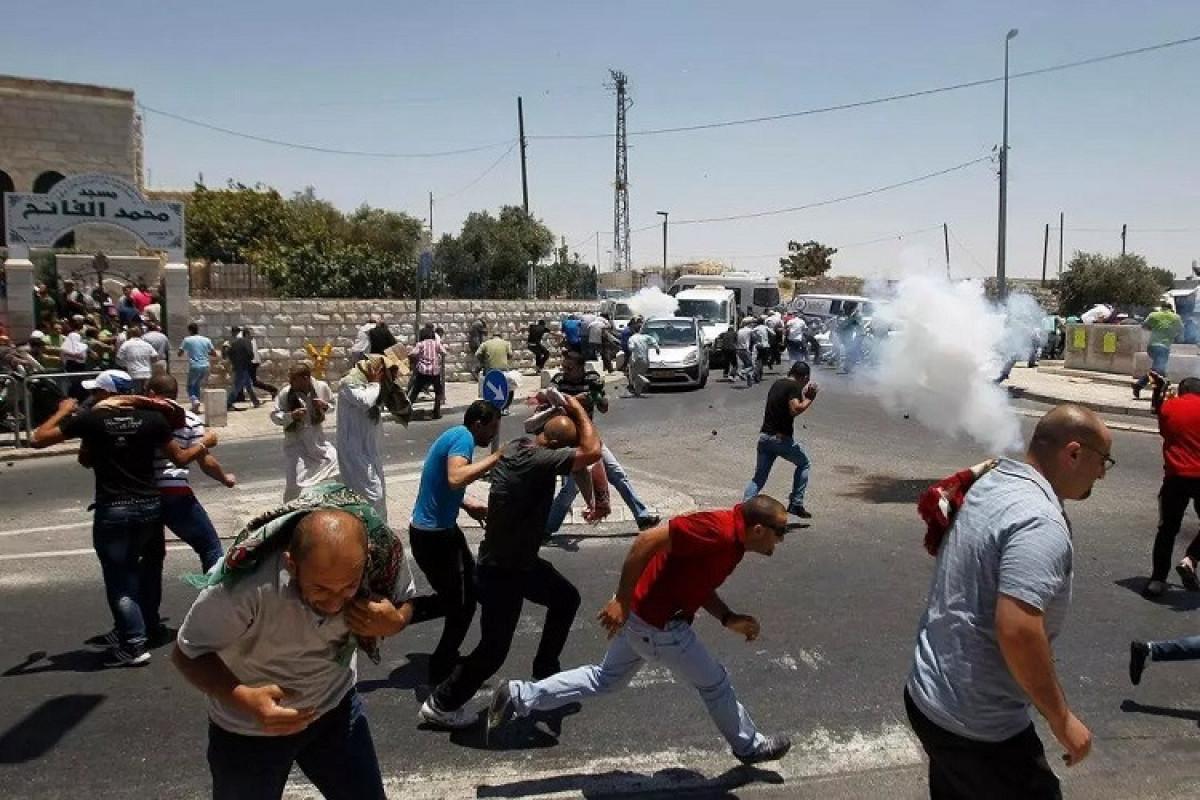 İsrail polisi ilə toqquşmalarda azı 75 fələstinli xəsarət alıb
