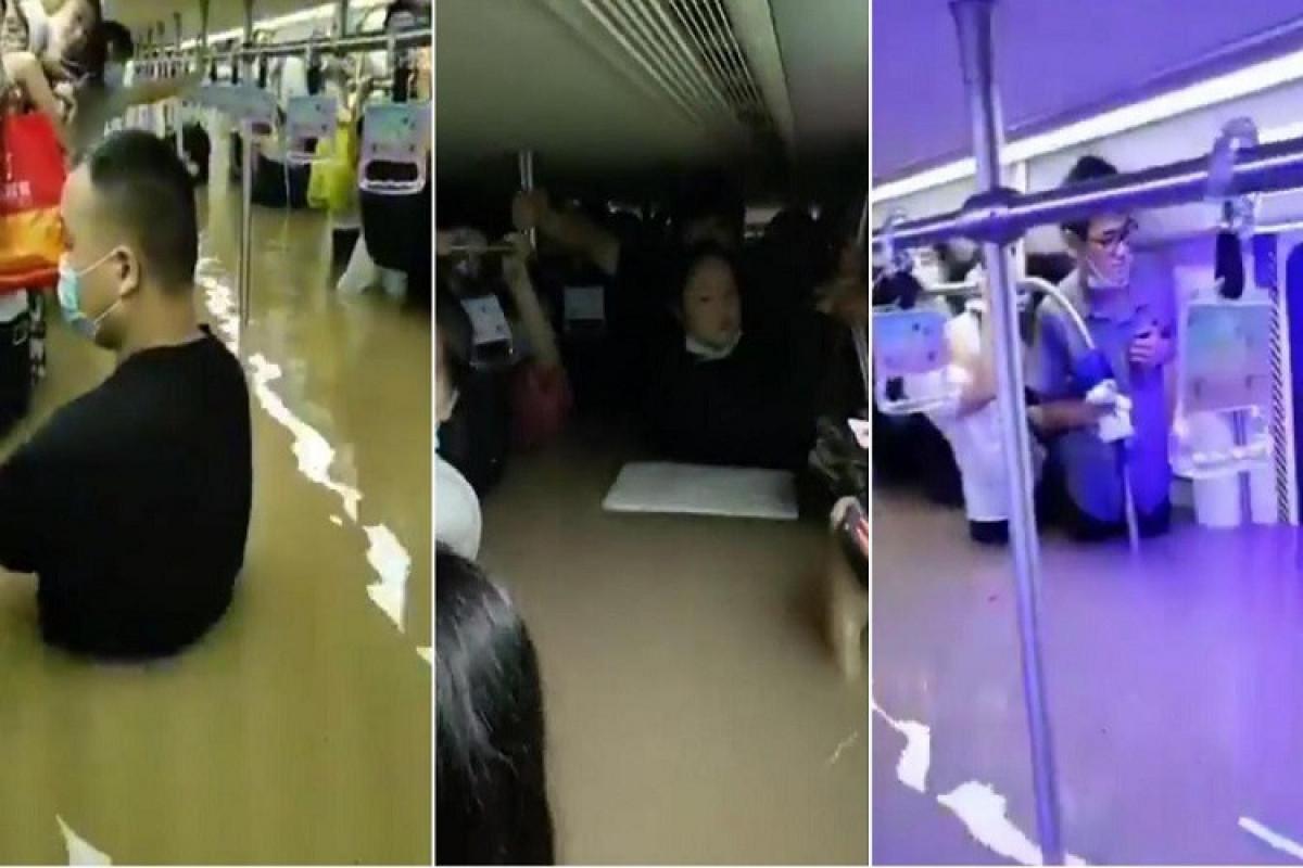 """Çində sel zamanı metro tunellərinə su dolub, ölənlər var - <span class=""""red_color"""">FOTO"""