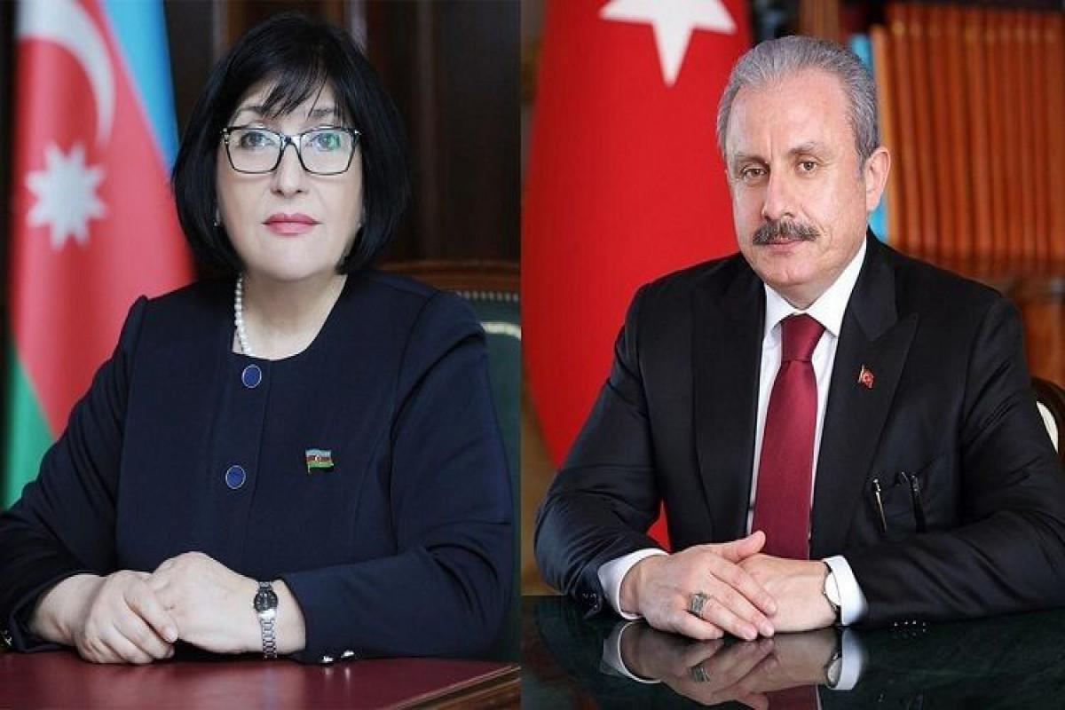 Sahiba Gafarova and Mustafa Shentop hold phone conversation