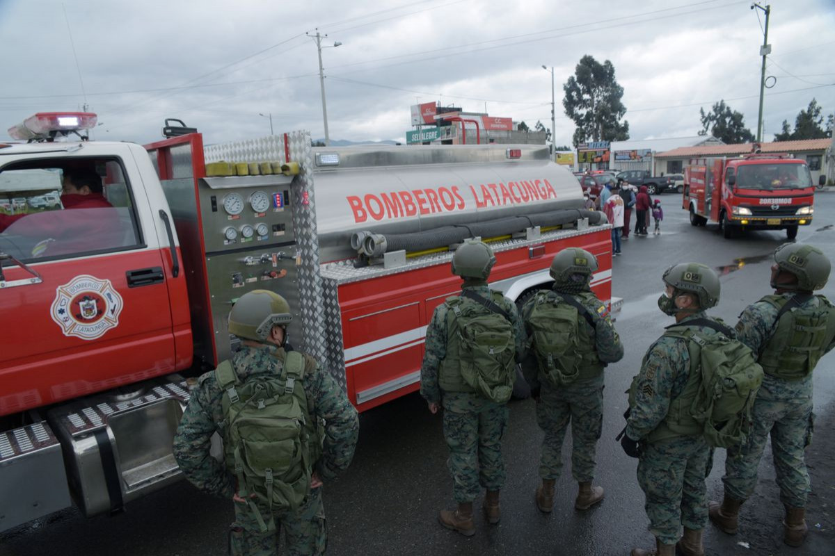 Ecuador says at least 18 inmates die in two prison riots