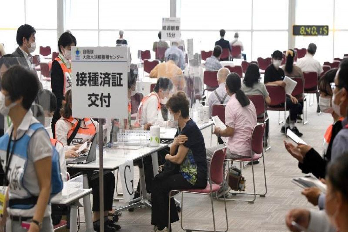 Japan to start vaccination at workplaces, universities