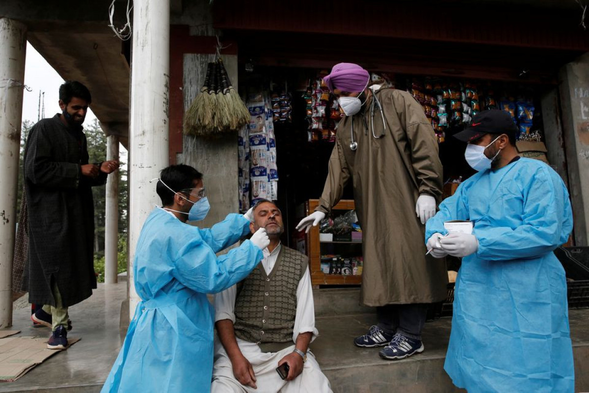 India reports 67,208 new COVID-19 cases, 2,330 deaths