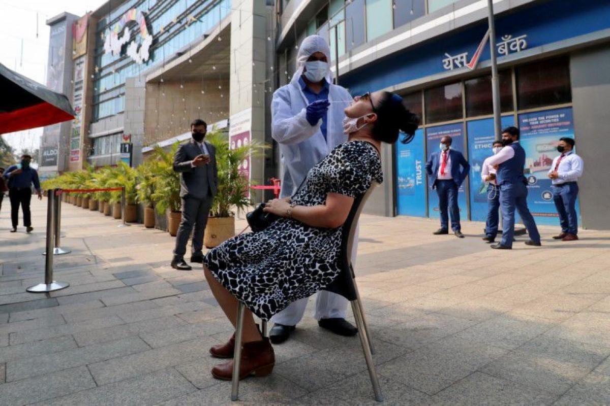 India reports 60,753 new coronavirus cases