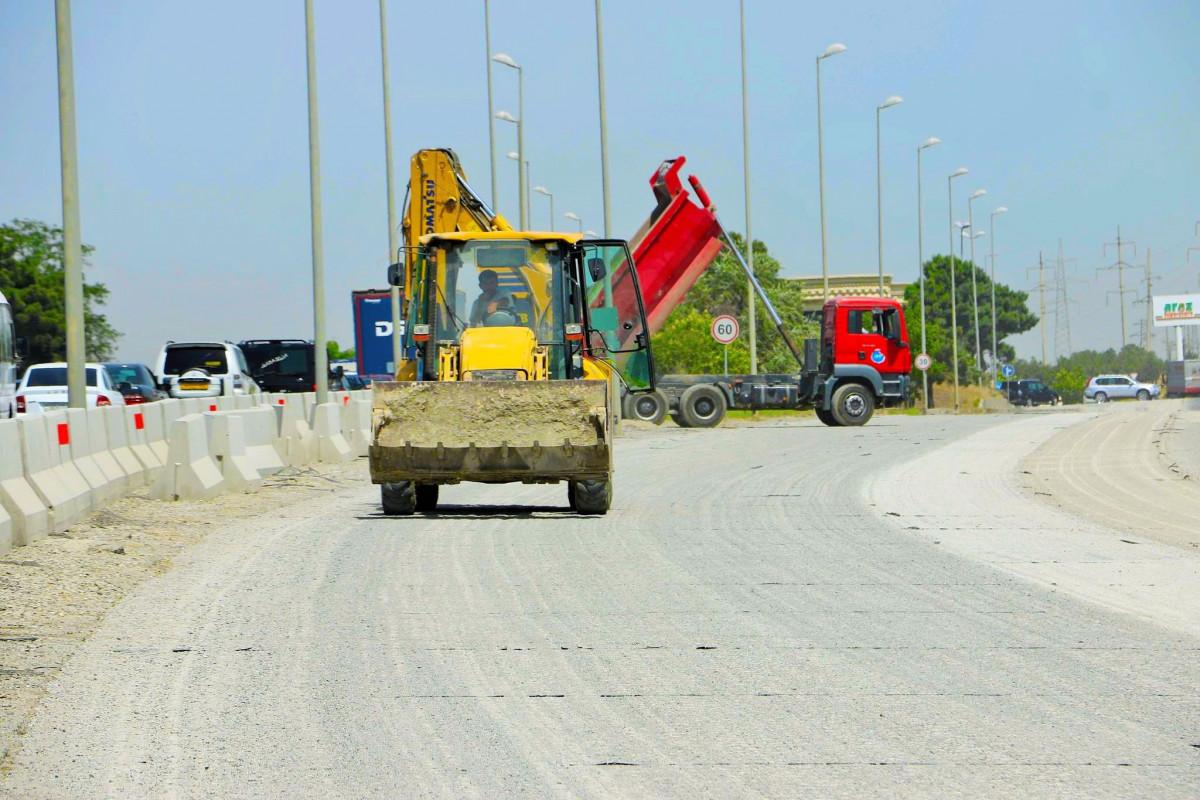 """M1 magistralının 16-30-cu km-lik hissəsində təmir-bərpa işləri davam edir - <span class=""""red_color"""">FOTO</span>"""
