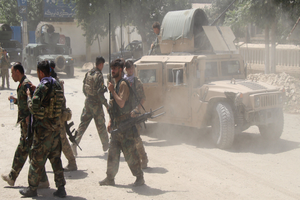 Afghan military cross into territory of Tajikistan as Taliban soldiers attack