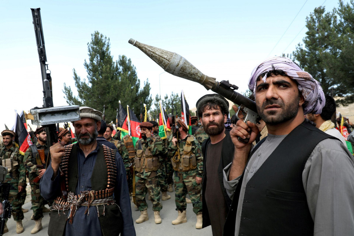 Afghan civilians take up arms as U.S.-led forces leave