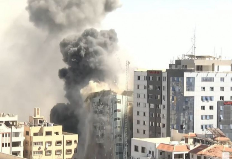 Building in Gaza with international media houses hit by airstrike