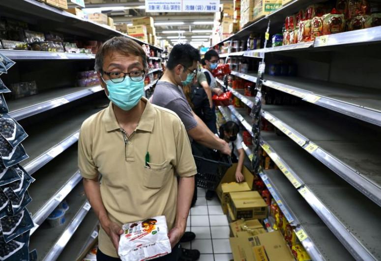 Taiwan urges no panic buying as new COVID-19 rules kick off