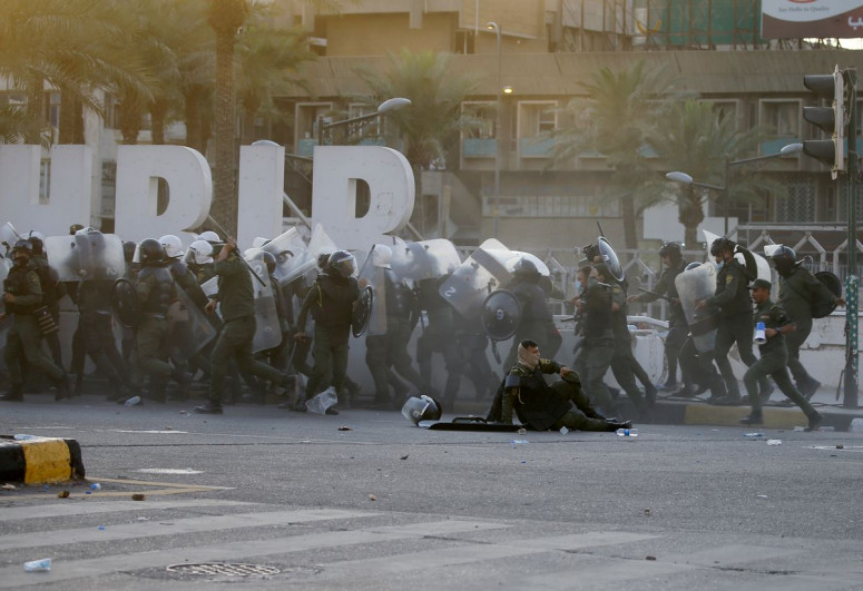 One protester dies after clashes with police in Baghdad - sources