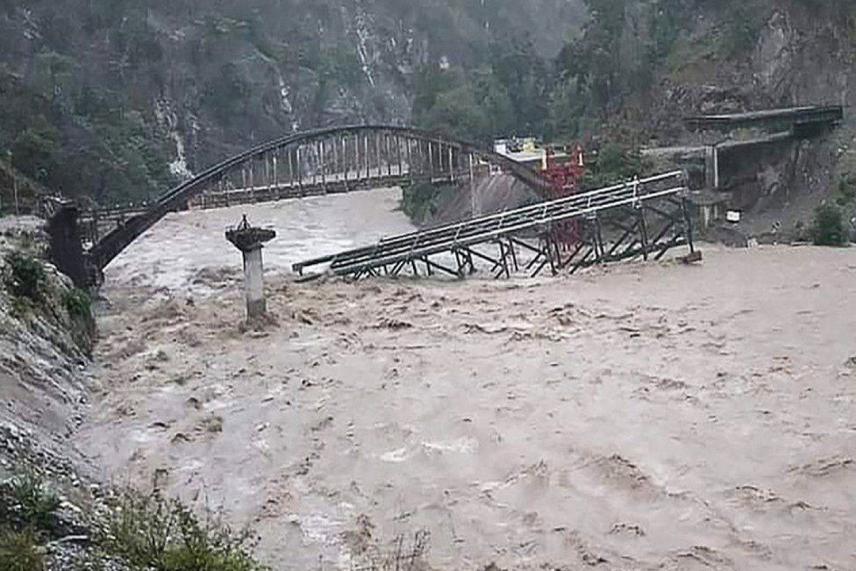 Overflowing rivers have swept away bridges as here in Chalthi, Uttarakhand