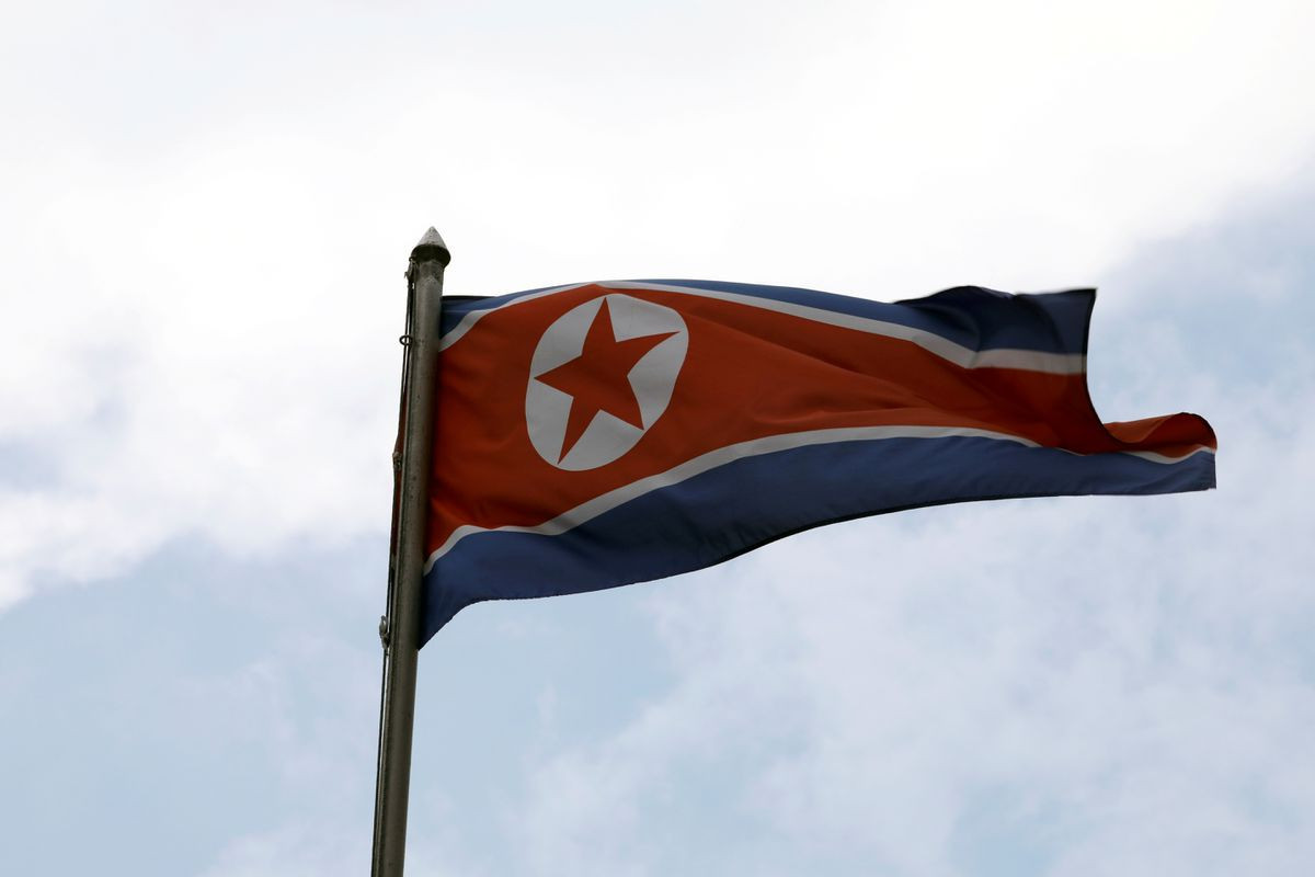 N.Korea puts hazmat suits on parade for national day, but no missiles