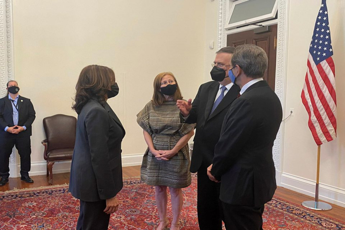 Mexican Foreign Minister Marcelo Ebrard chats with U.S. Vice President Kamala Harris, U.S. Secretary of State Anthony Blinken and Mexican Economy Minister Tatiana Clouthier